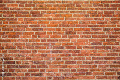 Deurstickers Baksteen muur Solid rustic red bricks wall surface