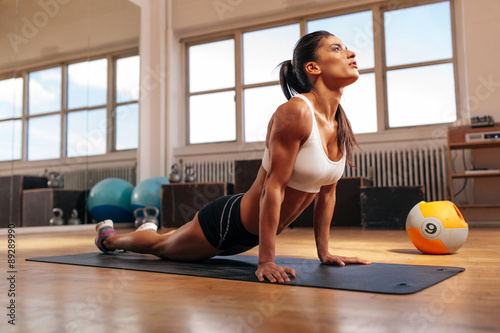 Woman doing core stretch in gym Canvas Print
