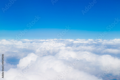 Fotobehang Hemel Blue sky with white clouds, aerial photography