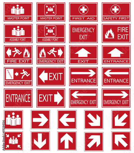 Vector emergency exit signs set on red background Wall mural