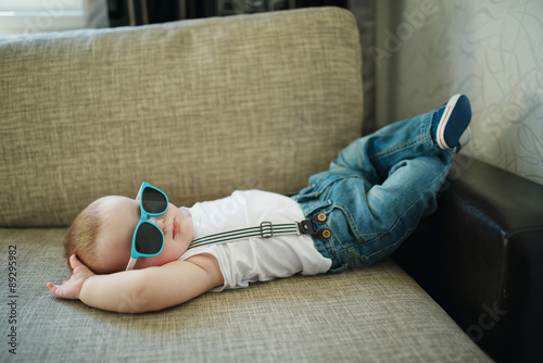 cute little boy in sunglasses Poster