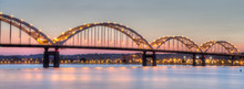Centennial Bridge Across The Mississippi River At Dusk Between Rock Island, Illinois And Davenport, Iowa