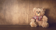 Teddy Bear On A Wooden Shelf