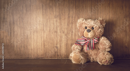 obraz lub plakat Teddy bear on a wooden shelf