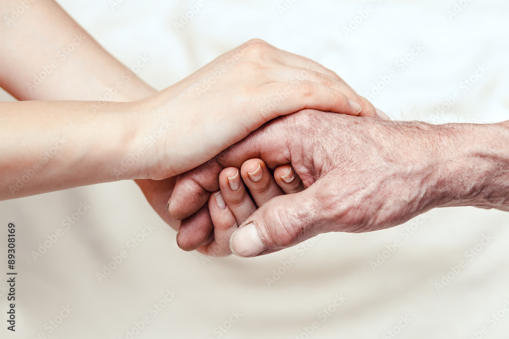 Fototapety, obrazy: Hands of the old man and a young woman. close up. toning
