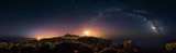 Fototapeta Landscape - 360° rectilinear panoramic view of starry night with milky way arc and lighthouse of Capo Spartivento