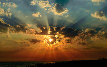 Rays Of The Sun In The Clouds