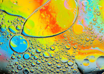 FototapetaBackground of colorful oil drops in water