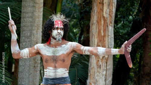 Photo  Yugambeh Aboriginal warrior throwing boomerang