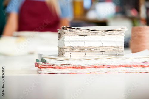 Valokuva  Stacked Papers Ready For Making Notepads On Table
