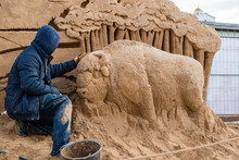 Sand Sculpture And The Sculptor At Work