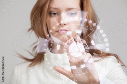 Fotografie, Obraz  Future technology. Woman working with futuristic interface
