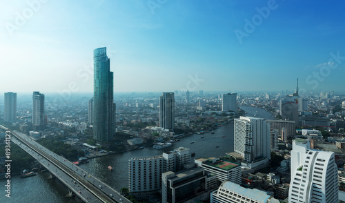 Canvas Print Chao Phraya river and high building sky scrapper in heart of ban