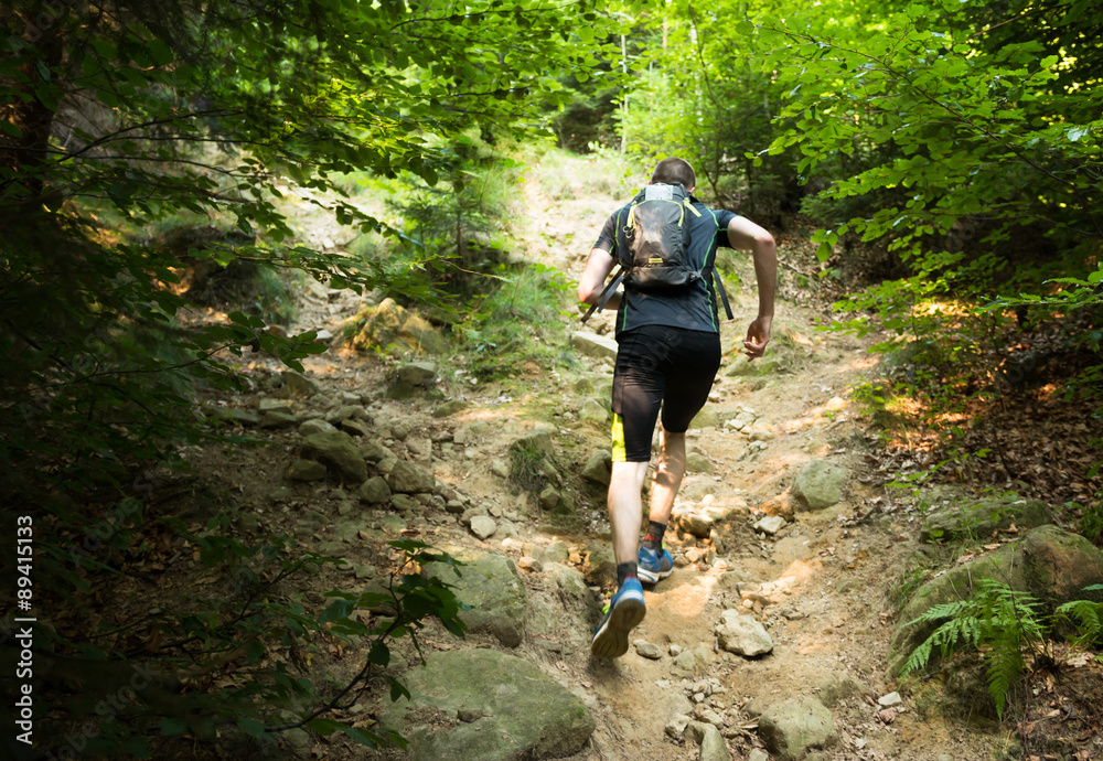 Fototapety, obrazy: trail runner with backpack running up the steep hill