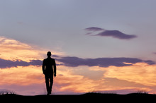 Silhouette Of Man Walking Busi...