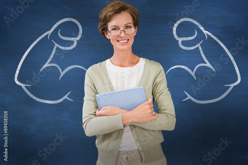 Cuadros en Lienzo Composite image of teacher holding tablet pc at library