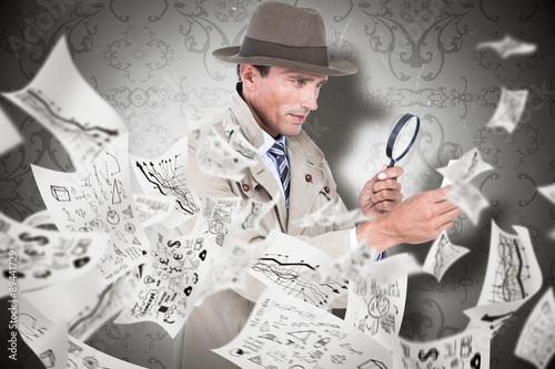 Fotografía  Composite image of spy looking through magnifier