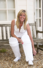 Woman Putting On Her Cricket P...