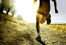 Silhouette Sport Man Running On Countryside In Cross Country At Summer Sunset