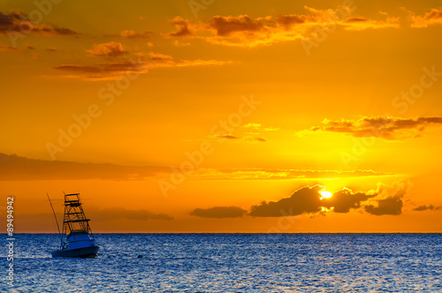 Beautiful sunset behind sport fishing boat on Maui, Hawaii, USA