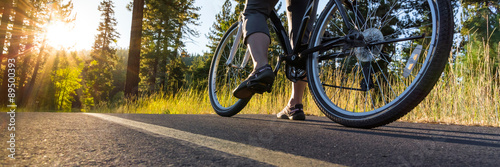 Foto op Plexiglas Fietsen Bike on asphalt path illuminated by the sun.