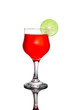 Red cocktail and lime on white background.