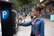 Young Woman Paying Her Parking Ticket