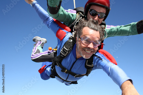 Skydiving tandem senior man
