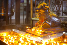 Sculpture Of Nandi   ( Bull ) And  Candles At Meenakshi Hindu Temple In Madurai, Tamil Nadu