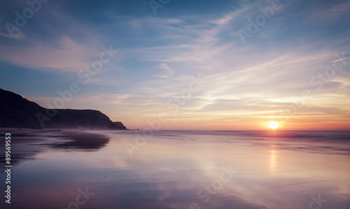 Portugal,View of Praia do Castelejo at sunset