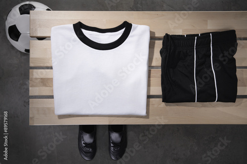 Football shirt,pants and shoes on bench,studio shot