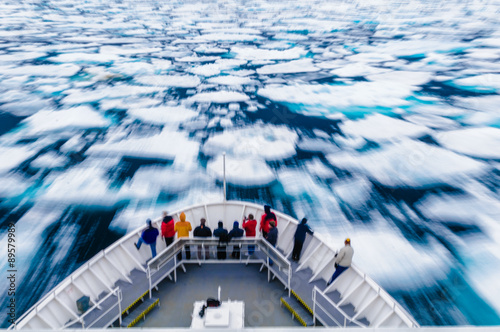 Garden Poster Arctic Slow motion blur of people standing on the bow of a ship.