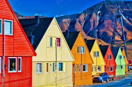 Photo Stands Arctic Digitally enhanced row of very colorful homes in Svalsbard, Norw