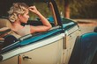 Beautiful lady passenger in a classic convertible