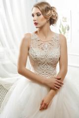 Naklejka Young beautiful bride, woman in long white wedding dress on whit