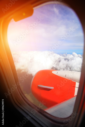 Airplane wing with blue sky Wallpaper Mural