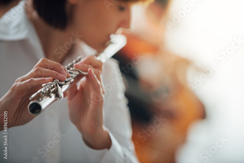 Canvas Print Professional flute player performing