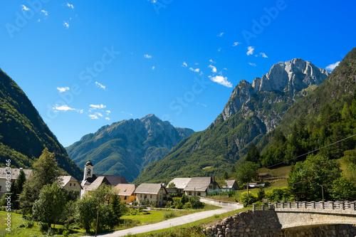 Fototapeta Small Village and Julian Alps - Slovenia / Small village (Bretto) in Julian Alps in the Triglav National Park - Bovec, Slovenia, Europe obraz