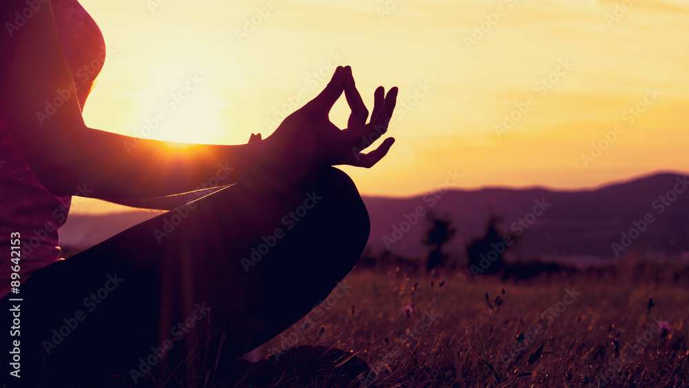 Fototapety, obrazy: Young athletic woman practicing yoga on a meadow at sunset, silhouette