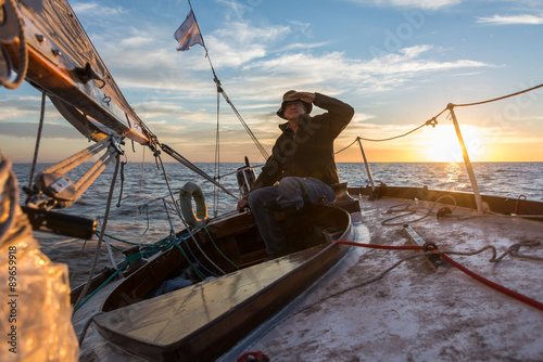 Foto op Canvas Zeilen Senior retired sailing Buenos Aires River to Uruguay. Sport free
