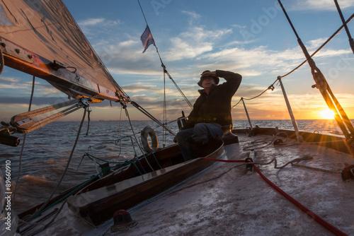 Staande foto Zeilen Senior retired sailing Buenos Aires River to Uruguay. Sport free