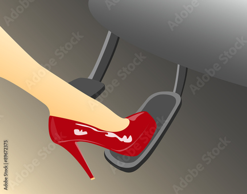 A woman's foot in a high heeled red shoe pressing the gas pedal in a car Canvas Print
