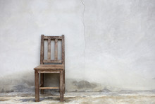Old Chair Against Old Wall Background
