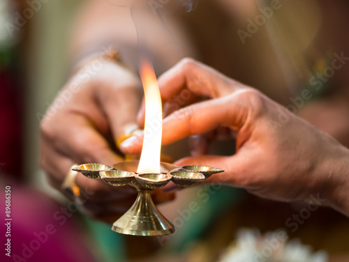 Aarthi being passed on in an Indian Hindu  Wedding