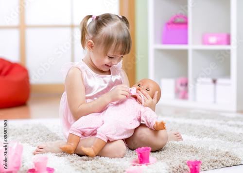 Valokuvatapetti Cheerful little girl play in preschool