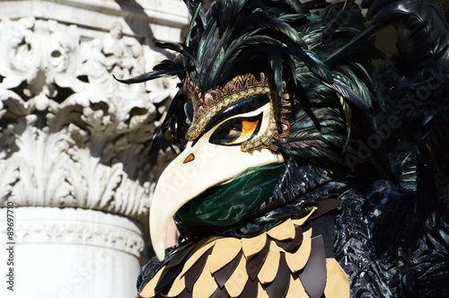 Feathered black bird mask at the Carnival of Venice, Italy #89697710