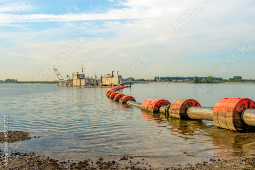 Fotografia, Obraz  Floating suction dredge in the river