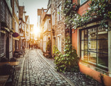 Fototapeta Room - Old town in Europe at sunset with retro vintage filter effect