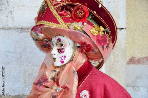 Fototapety, obrazy: Amazing painted mask and pink outfit at the Carnival of Venice in Italy