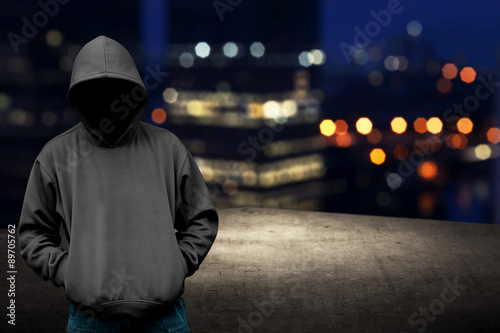 Faceless man in hood on the rooftop Fotobehang
